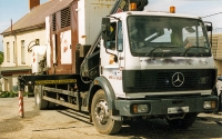 Mercedes flatbed trailer with mounted HIAB crane