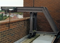 Window cleaning trolleys and rails - multi-storey cleaning system.